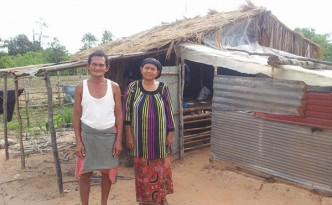 MRL and his wife in front of their home