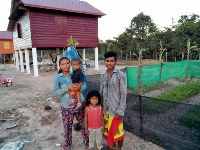 KN and his family in front of their new home